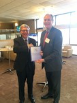 Managing editor, Russel Hirst presents copy of IJNS to Ron Lehman