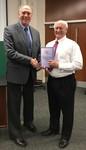 Managing editor, Russel Hirst presents copy of IJNS to John Norton Moore