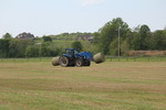 Round Bales Being Carried from the Field