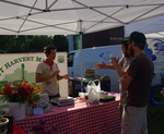 Organic Intern Elias Attea Conversing with Farmers Market Participants